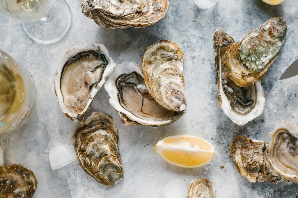 oysters with lemon and champagne on a marble background